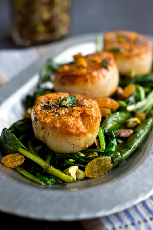 scallops, raisins, spinach, fish, olive oil, pistachios, food, food style, chef